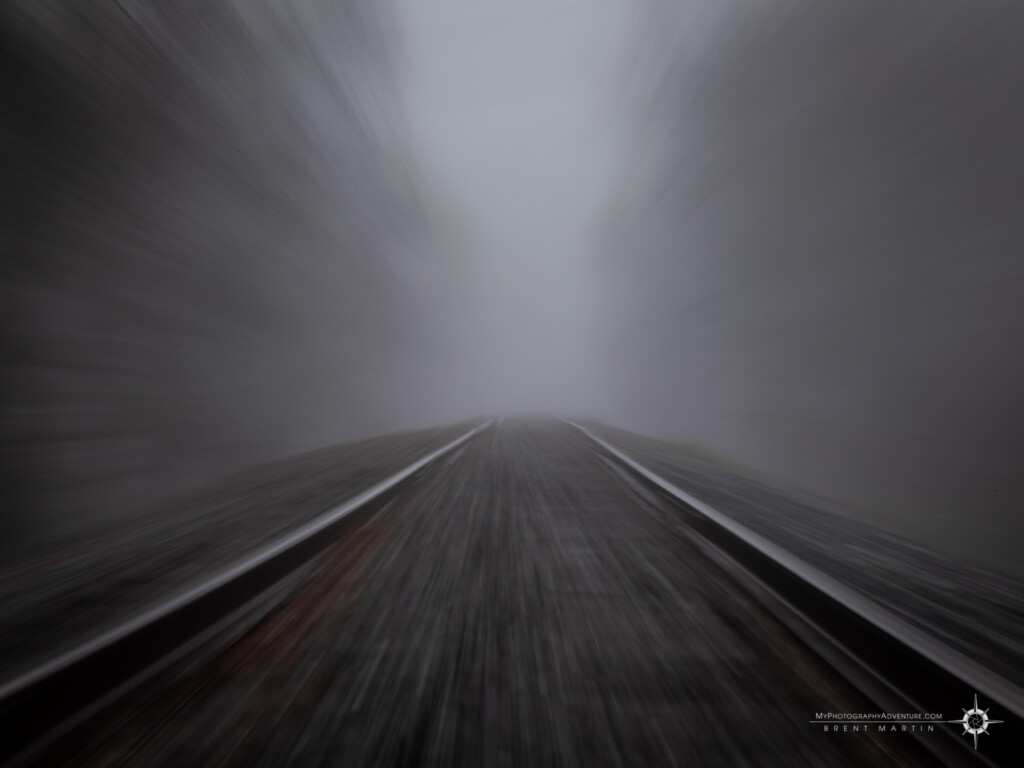 Zoom blur of railroad tracks in fog